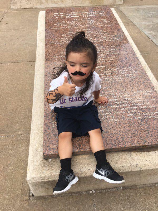 Yo this little girl going Steven Adams mustache/tattoo combo has already won fan of the game
