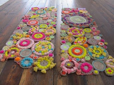 Twine & wool & pom pom rugs.  Tutorial: http://blog.freepeople.com/2011/05/wednes-diy-68/  Definitely a time consuming effort.