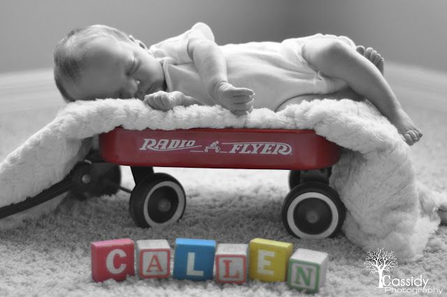Newborn Baby Unique Photography with Block letters and wagon.