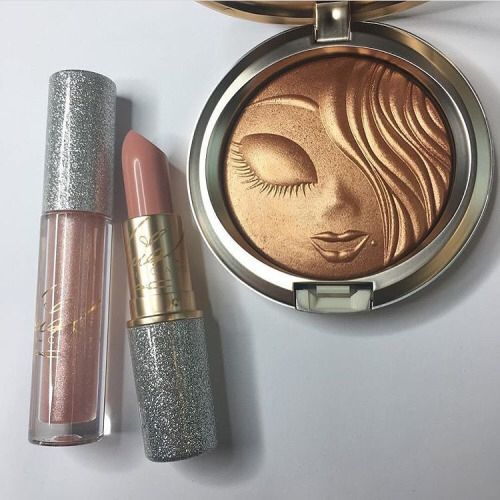 I can't wait until this launches. That lipstick and golden highlight have my name all over em!