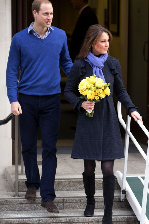 December 6, 2012 — After being treated for morning sickness for her first pregnancy, Kate left the King Edward VII Hospital looking cozy in a navy Diane von Furstenberg coat, blue scarf and tall black boots.