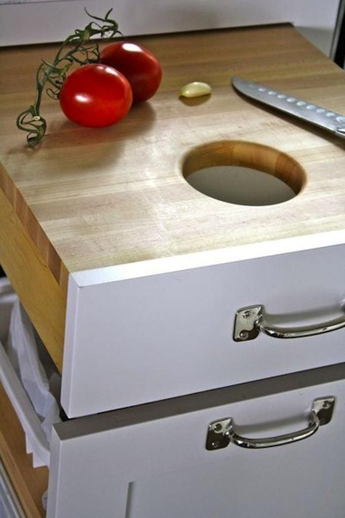 Pull out drawer cutting board w hole for compost bin in a drawer below. Solves multiple space problems in one clever soultion.