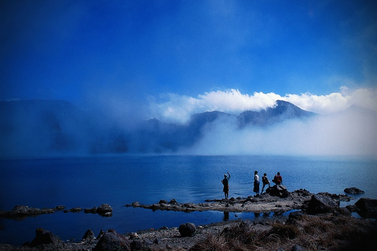 A spellbinding scenery of the Segara Anak Lake at Mount Rinjani in West Nusa Tenggara. Standing at a staggering 3,726 meters above sea level, Mount Rinjani is the second highest mountain in Indonesia, and is a favorite among mountaineers.
