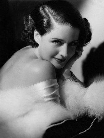 Norma Shearer 1934 by George Hurrell for MGM.  costume by Adrian
