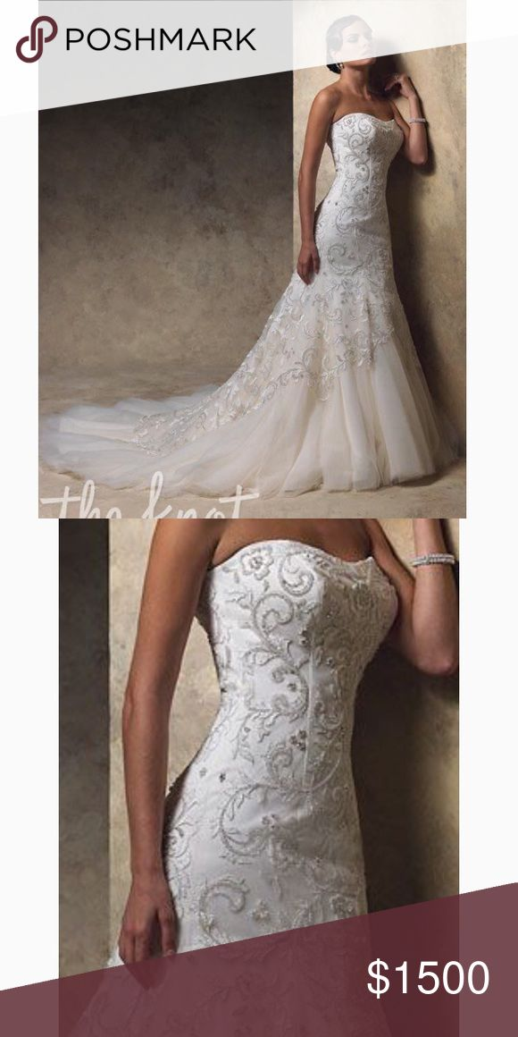 Rina Di Montella Wedding Dress, size 4. Imported. Exquisite Rina Di Montella Wedding dress, mermaid silhouette size 4. Imported from Italy. Has been professionally cleaned and preserved in air tight storage case and is in excellent condition. Rina diMontella Dresses Wedding