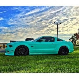 Representing Royal Purple Ladies, Nikki Frost's Tiffany blue wrapped 2013 Mustang GT. garcia