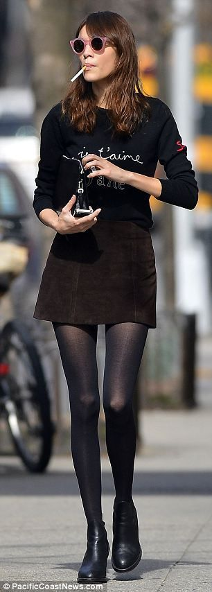 Alexa Chung channels a sixties beatnik as she takes a break in the New York sunshine