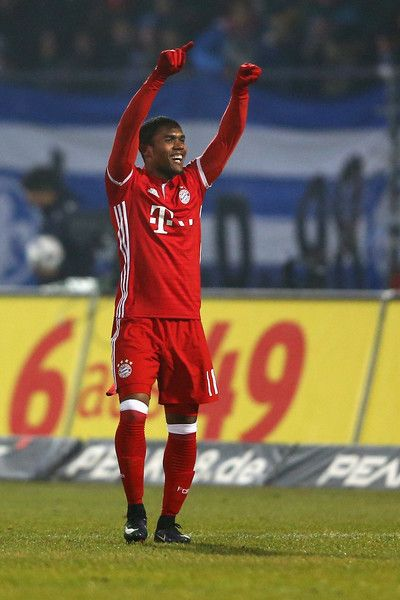 Douglas Costa of Bayern Muenchen celebrates the first goal  during the Bundesliga match between SV Darmstadt 98 and Bayern Muenchen at Stadion am Boellenfalltor on December 18, 2016 in Darmstadt, Germany.