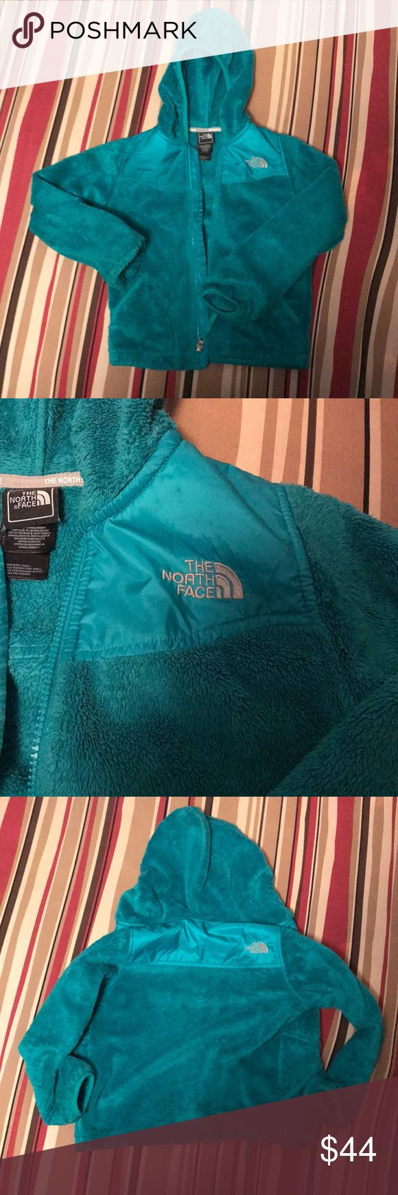 Kid's North Face jacket Comfortable North Face jacket.  Words are wearing off along the inseam of the hood, sight discoloration in some places, and slightly worn on the hands, but besides that it is in good condition overall. Size S (7/8) Beautiful blue - green color North Face Jackets & Coats