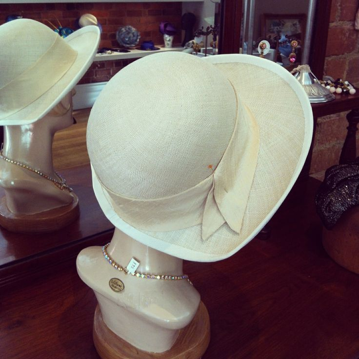 """Linen straw cloche - 22"""" dome block and small doughnut brim block - cut away back, floating wired and bound brim.  Silk band cut on bias and trimmed with vintage brooch"""