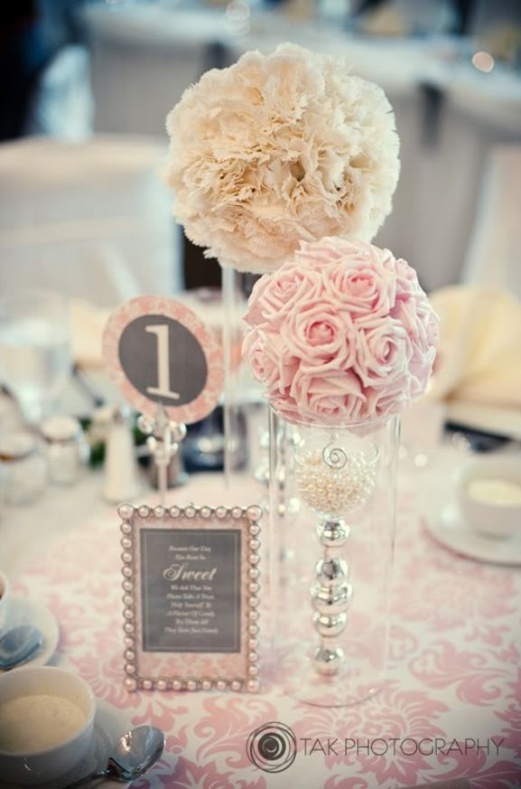 this is just the sweetest wedding centerpiece! ivory and blush pink pomander combo (ivory carnations pomander + blush pink rose pomander) - with grey and pink placecard accents... rose pomander, pearls, silver accents Just thought they were cute, may not totally be with your theme though