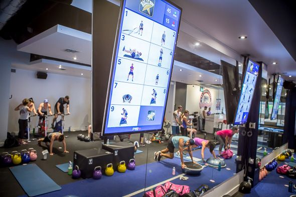 F45 Training is a group fitness studio in Liberty Village that follows a fully interactive group training circuit. It speaks to the popularity of the gym and the effectiveness of the workouts that the gym is packed at 9 a.m. on a Saturday. Or perhaps it's the live DJ we're...