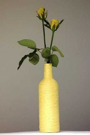 Yellow pastel spool knitted glass bottle vase by www.kadovanwolenzo.nl