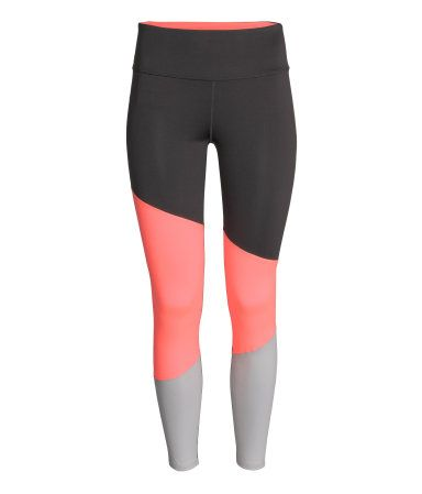 Color-block sports tights in fast-drying, functional fabric with wide ribbing to hold in and shape waist. Concealed mesh key pocket in waistband. | H&M Sport