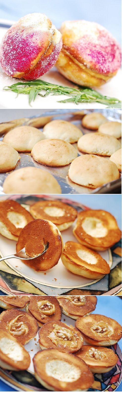 """Pechenie persiki"" - peach shaped sandwich cookies with dulce de leche and walnut filling."