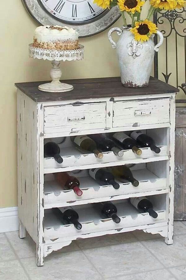 old dresser repurposed into a wine rack