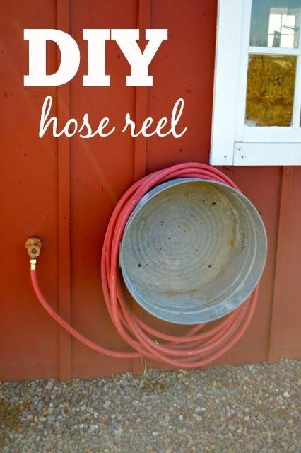 Use a vintage metal washtub as hose reel