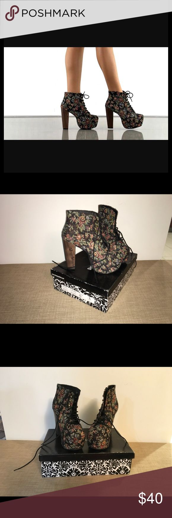 """Shoe Republic Floral Tapestry Bootie Tap into the tapestry trend with the Shoe Republic LA Visalia Black Floral Tapestry Platform Booties! Beautiful floral embroidery on a black backdrop has a rounded square toe, with black shoestrings lacing through brass grommets up to the ankle, plus hiker-inspired hooks to top it off. 2"""" hidden platform pairs with a chunky 5"""" faux wooden heel (plus rubber tip). Lightly cushioned insole. Non-skid felted sole. Fit runs HALF SIZE SMALL.  All vegan friendly…"""