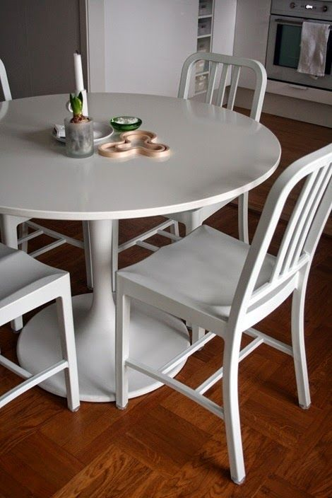 White Emeco Chair with Tulip Table