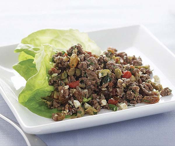 Beef Picadillo - A Latin American and Caribbean favorite, picadillo is a savory-sweet ground beef filling that's delicious wrapped in lettuce leaves. It's also good in tacos, quesadillas, and omelets. http://www.finecooking.com/recipes/beef-picadillo.aspx