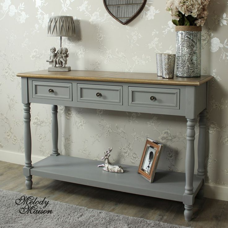 Admiral Range - Three Drawer Sideboard/Console Table A large console table/sideboard with 3 drawers for storage and shelf below In a grey painted finish with a natural wood panelled top and brass cup handles A great storage solution for the kitchen or hallway Please see other items available in this ranges www.melodymaison.co.uk