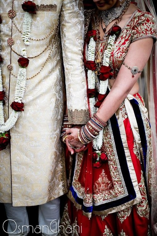 indian bride and groom with flower garlands, jai mala, red indian bridal lehenga
