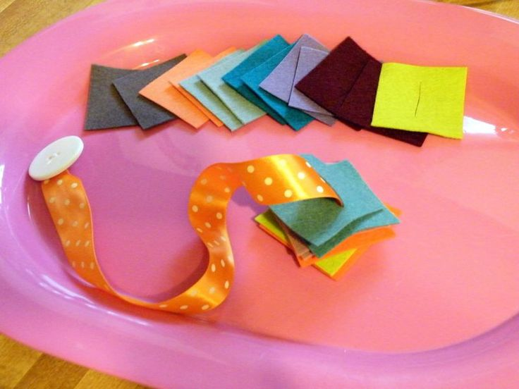 It's a great way to teach preschoolers Button snake.. the complex practical life skill of buttoning and unbuttoning while having a whiz bang of a time.    and other montessori ideas..