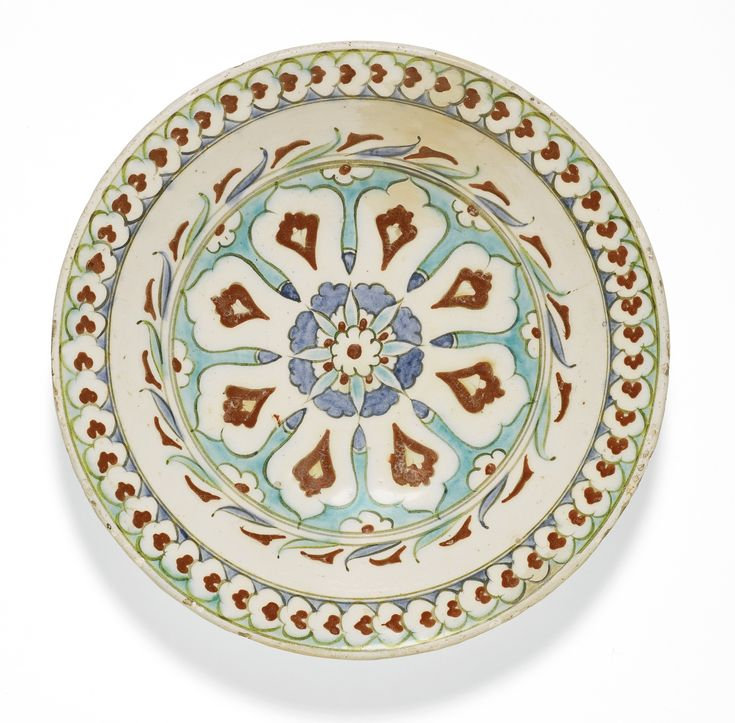 An Iznik polychrome pottery dish with a lobed arch design, Turkey, circa 1600   Lot   Sotheby's