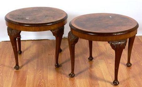 A pair of walnut occasional tables, each with crossbanded circular top raised on acanthus carved cabriole legs terminating in pad feet, 64cm diameter x 48cm high..