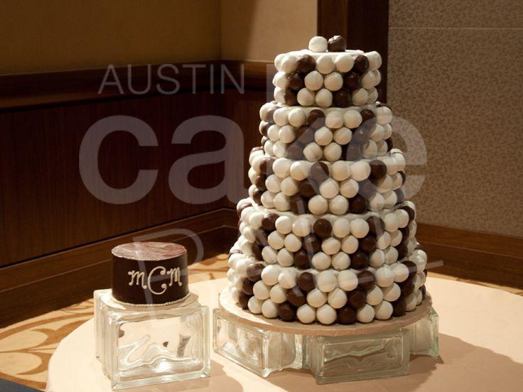 A Spiraled Cake Ball Wedding CakeTM With Monogrammed Cutting