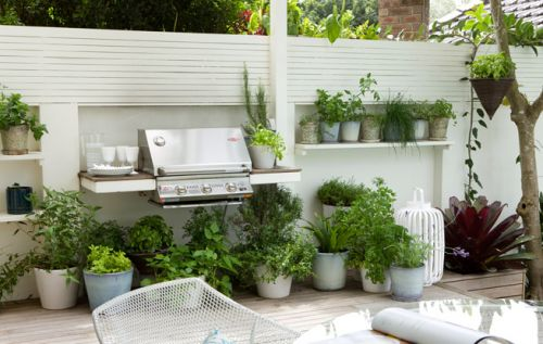 LOVE the herbs by the BBQ. That way you could snip off some sprigs right as you need them!