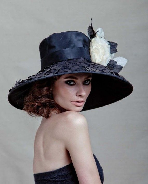 Couture Derby Hat made of black taffeta with square paillettes around the brim by Arturo Rios