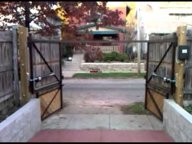 Solar Power Dual Driveway Gate System.  Go Green, You can have a solar panel on many automatic gate systems.  Call us about Solar Power Automatic Driveway Gates
