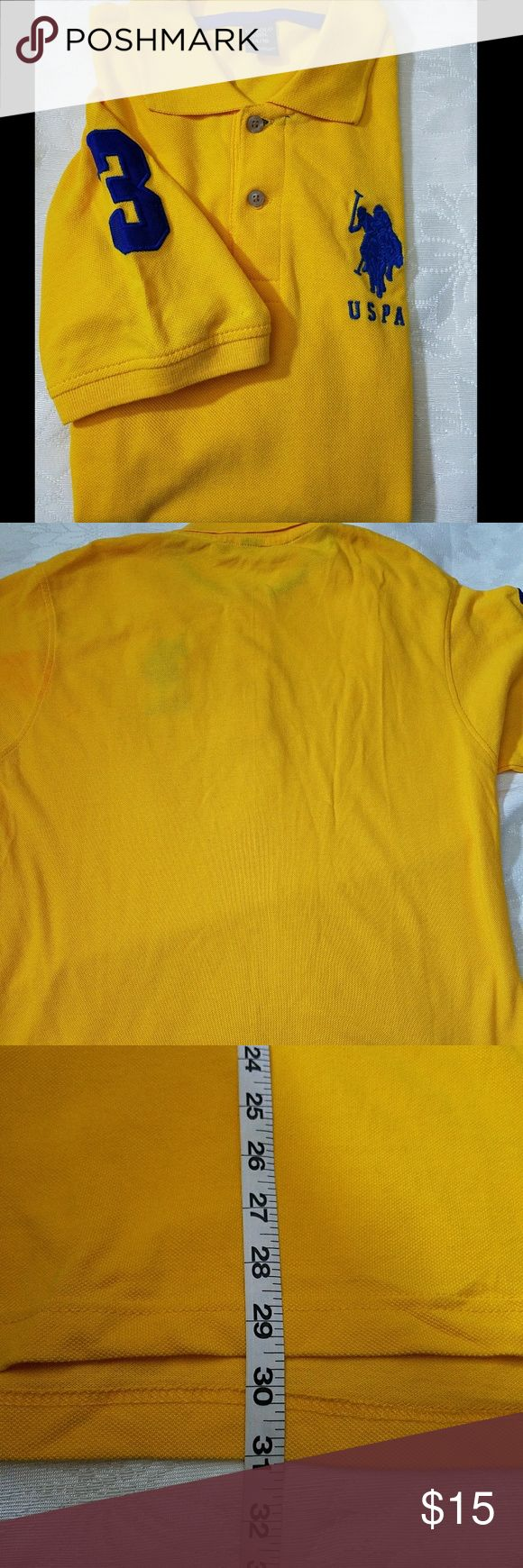 U.S. Polo Association Yellow Polo Size Mens 14/16 This gently worn golden yellow polo is in good condition except for a small stain at the bottom which is very faint. Last photo shows how small the stain is.   Made of 100% cotton.   Please see photos for measurements and details.   Add to a bundle to save U.S. Polo Assn. Shirts Polos