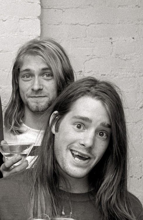 Kurt Cobain ( with what looks like a martini) and Chad Channing