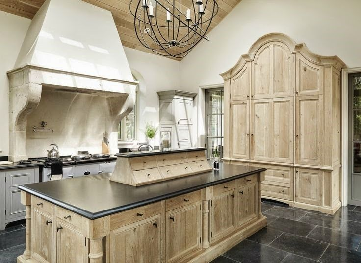 bleached oak and lovely floor and countertops.  Also the upper cubbies look practical.