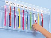 Bathroom organization for large families.  Where to put the toothbrushes has always been a problem.