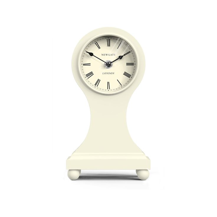 The Holland Park This tall and curvaceous wooden mantel clock has a fine waistline and rests on a plinth of balled feet. A classic mantel clock in a contemporary cream colourway.
