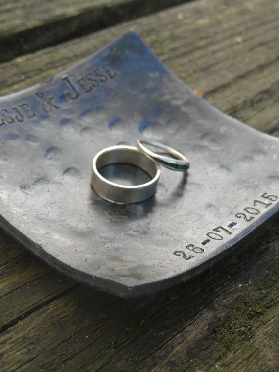 Beautiful, personalized, forged iron wedding ring dish! This handmade dish will be a unique way of presenting the rings on your wedding day. It is a plate that is loved by brides and grooms and is perfect for both rustic and modern weddings. After the wedding it is perfect to keep your rings on when not wearing, or just add a little tealight to use it more decorative.  The dish measures approximately 4 (10cm) by 4 (10cm). You will be able to choose your own engraving, up to 35…