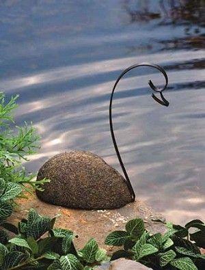 Beatiful in its simplicity: Ancient Graffiti Rivestone Metal Swan via Backyard Bird Company