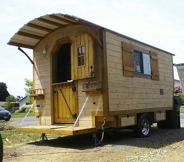 This story is about a rustic looking little cabin on wheels. It's mounted to a 6 x 10 single axle trailer.