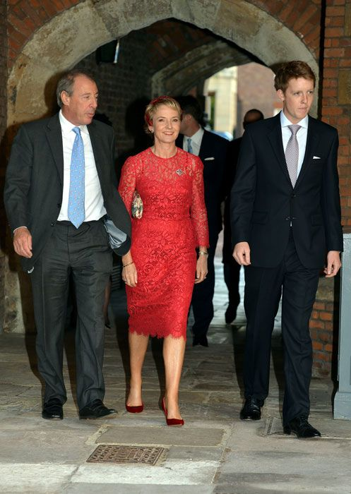 Diana's friend, Julia Samuel arrives with fellow godparent Hugh Grosvenor on right.