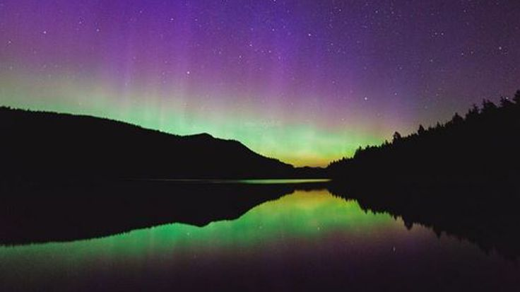 A large geomagnetic solar storm visible created a stunning opportunity for stargazers and photographers to catch a glimpse of Aurora Borealis this weekend.