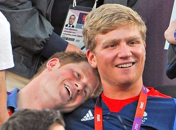 Prince Harry rests his head on Constantine Louloudis's shoulder... and I kind of want to paste my face of Constantine's