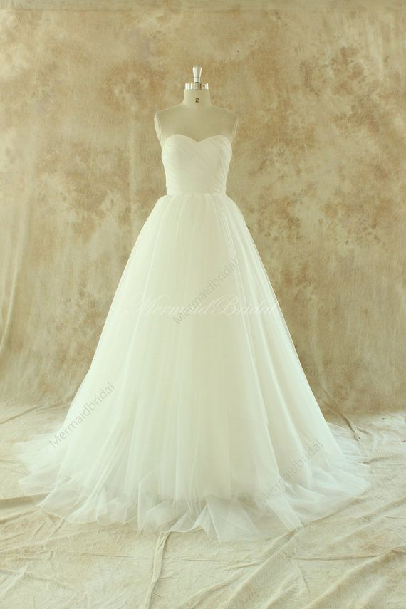 Ivory lace A line tulle wedding dress with removable train  Fabric:Tulle,Lace  Embellishment: Lace  Straps:Strapless  Sleeves: Sleeveless  Back: