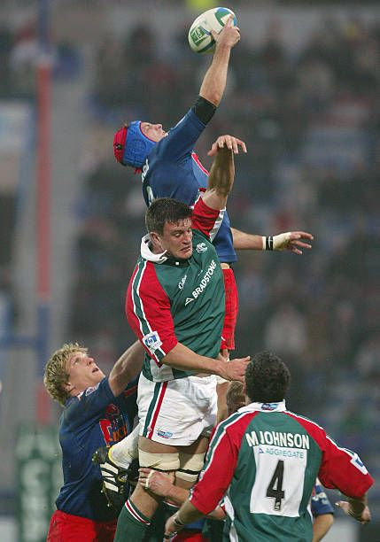 Stade Francais' N·8 Pierre Rabadan jumps for the ball on a touch line helped by his teammate flanker Remy Martin next to Leicester's flanker Martin...