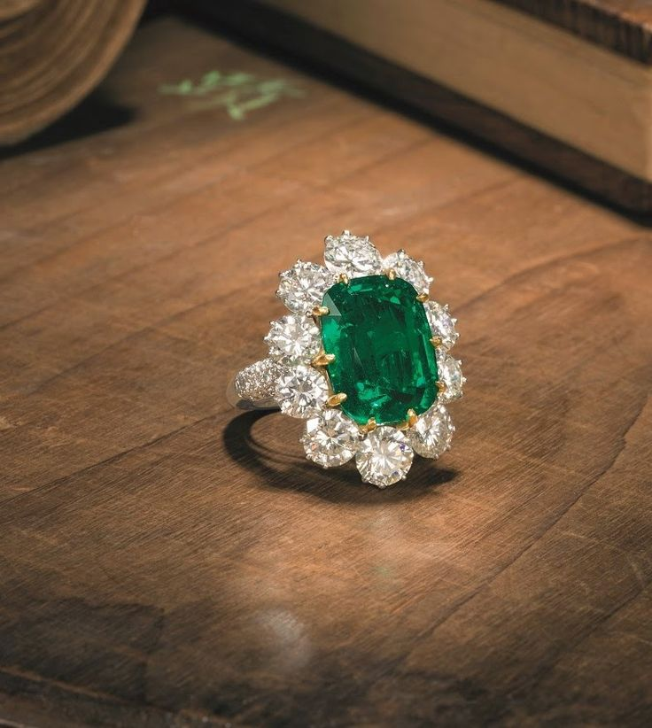 Emerald and Diamond Ring - 10.09 ct cushion-cut emerald - brilliant-cut diamond surround - $933,558 at auction
