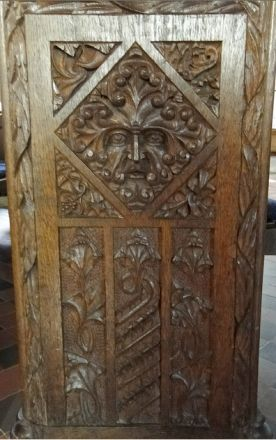 Green Man on a bench end in Dunster church, Somerset, England (photo Rex Harris)