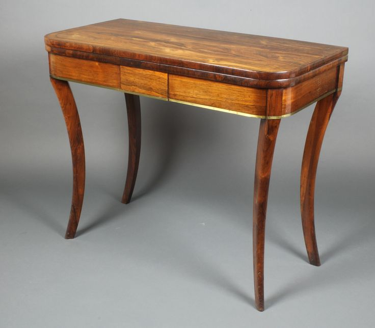 "Lot 1206, A Regency D shaped inlaid brass card table raised on sabre supports 29""h x 36""w x 18""d, est £600-800"