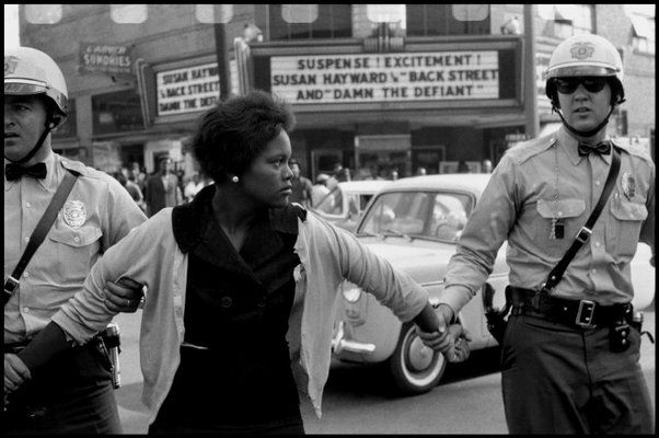 BIRMINGHAM, Alabama, 1963 — A woman protester being arrested and led away by police    © Bruce Davidson / Magnum Photos